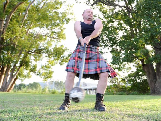 BIG SWING: Maclean Scotsman Norman Gray practicing the hammer throw at Maclean Showgrounds before this weekend's events. Photo: Debrah Novak