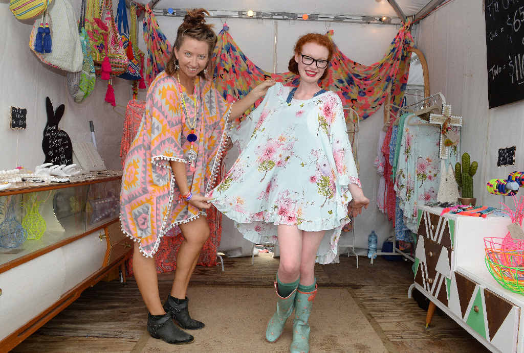 Maggie Jones of Alska label with Emma Bentley from Canberra trying out the fashion at Bluesfest, 2015.