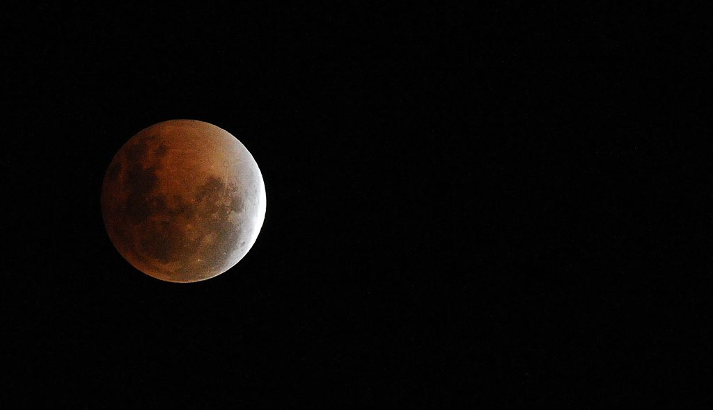 Tonight's blood-red moon coinciding with Pass-over has some local Bible scholars bracing for a dramatic change in world-wide events.