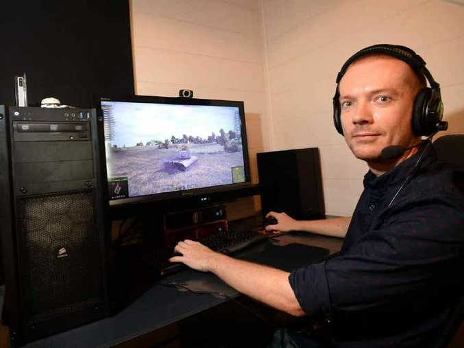 PRICEY PIECES: Rockhampton's Jamie Glendenning has spent over $5000 on his computer set-up and is planning to spend more money on it in the coming months.