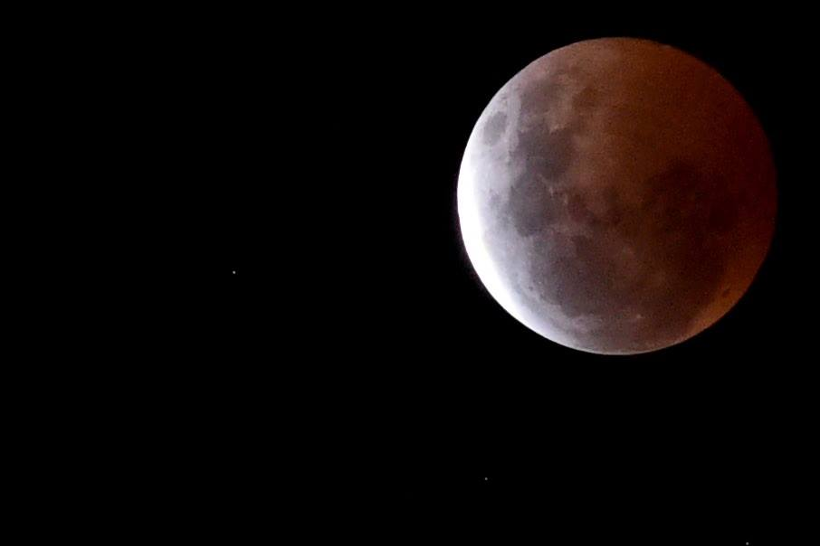 A lunar eclipse, a super moon and a sinkhole - what does it all mean?