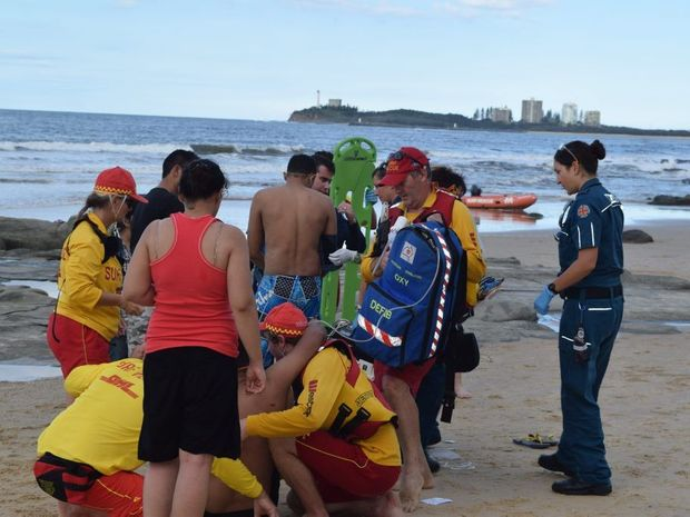 EMERGENCY crews and surf life savers carry the man involved in a near drowning at Mooloolaba into the awaiting ambulance. Photo: Roxanne McKarty-OKane / Sunshine Coast Daily