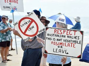 Protesters prepare to make their way along Torquay beach on Easter Saturday.