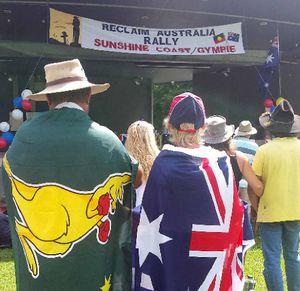 BOXING KANGAROO: Residents draped in flags listen to Reclaim Australia rally speakers.