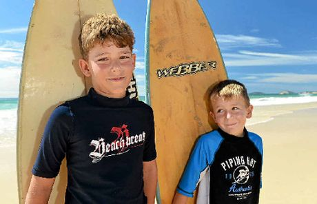 SUN AND SAND: Tane Bentley, 9, and Malakhi Bentley, 6, from Cooloola Cove.