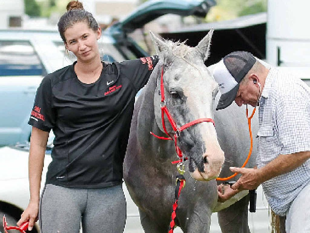 ABOVE: Hannah McQueen and Debra McQueen at this year's event.LEFT: An injured Jessica Langridge waits patiently while her horse is checked by a vet.BELOW: Stan Taylor leads his horse.