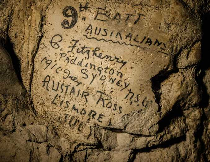 WAR GRAFFITI: Names engraved on the walls of a former chalk quarry, at the Cite Souterraine, Underground City, in Naours, northern France by 9th Battalion Australians, G Fitzhenry of Paddington, Sydney from 1916 July and Alistair Ross, of Lismore. The names are just some of nearly 2000 First World War inscriptions at the site.