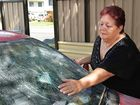 Irene Case is distressed after her car windscreen was shattered by a wine bottle.
