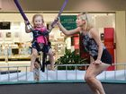 Two-year-old Mylee Briggs, of Townsville, hones her trampoline skills at Aero Jump with the help of her mother, Peta Briggs.