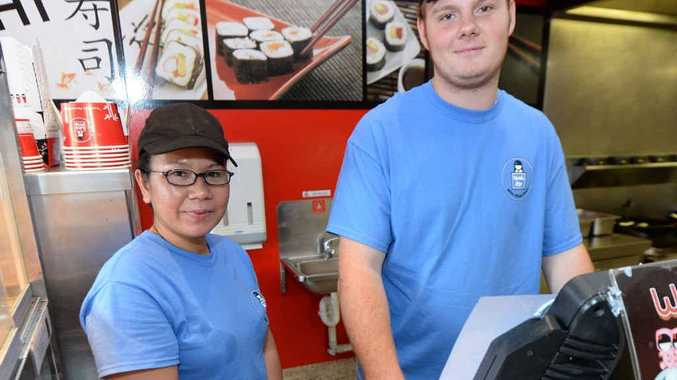 ACT OF KINDNESS: The staff at Wok Me, including Sam Cheha and Jesse Kelly, are impressed that every customer returned to pay their Cyclone Marcia IOU.