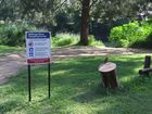 A turtle sign installed at The Point swimming spot on the Bellinger River.