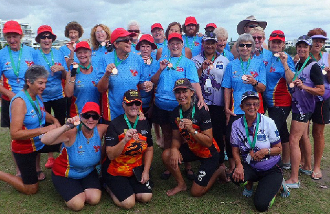 DRAGON BOAT: Wide Bay Dragon Boat team members show off the bronze medals they won at Lake Kawana (back, from left ) Norma Sanderson, Andrea Casey, Elaine Dimock, Ros Gill, Kath Pike, Gary Jones, Jean Peters, Shane Berkhout, Judith Summers, Maree Dawes, Nathan Gowlet, Kerri Southern, Hine Hill (middle) Jan Reuter, Gayle Barnet, Jan Low, Sandra Binnie, Sue Clacher, Jan Hughes, Suzan Malligan, Shary
