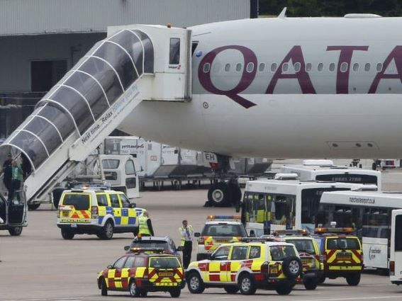 After being kept on a Qatar flight for more than five hours after landing, passengers began to clash with staff.