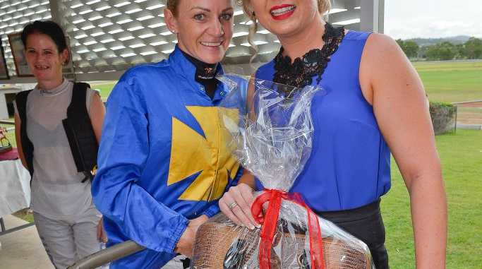 Jockey Tracey O'Hara inspired the winning outfit worn by Amber Voss.
