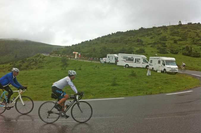 Nearing the finish line and the rain still continues, Hautacam climb, 2014 Etape du Tour. Photo: Iain Curry / Contributed.