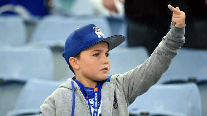 BULLDOG YOUTH: A supporter gestures at the end of the round five NRL match between Canterbury Bankstown Bulldogs and South Sydney Rabbitohs at ANZ Stadium. PHOTO: MICK TSIKAS