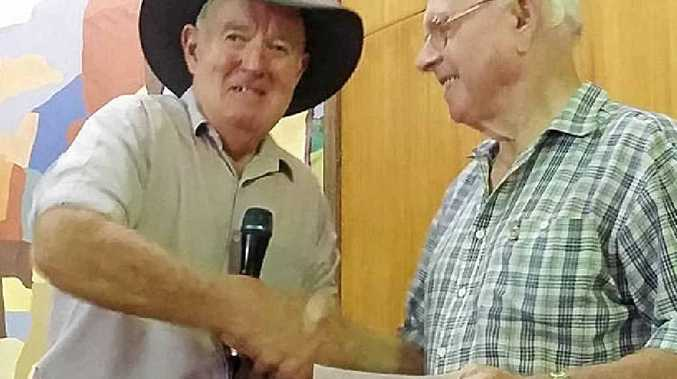 COMMUNITY SUPPORT: Gympie Country Music Club president Wally Westlake (left) with the Masonic Lodge's Kev Ward.