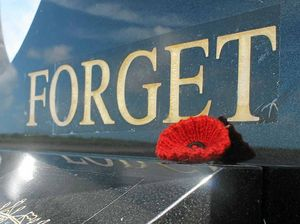 Heartfelt act with a single poppy left for soldier