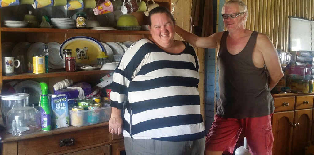 STILL SMILING: Karen Johnson and her partner Rob are still without power and hot water almost seven weeks after their home was devastated by Cyclone Marcia. Their resilience has been tested to the point of exhaustion.