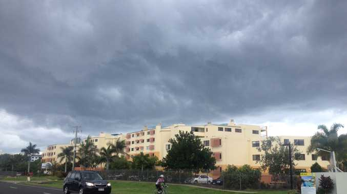 Rain clouds loom over cyclist at Marcoola