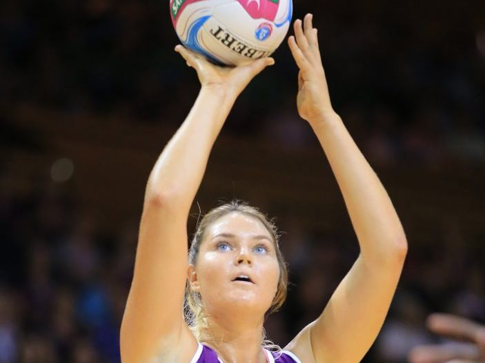 Gretel Tippett in round 1 of the 2015 ANZ Championships Netball being played at the Brisbane Convention Centre between the Queensland Firebirds and West Coast Fever.