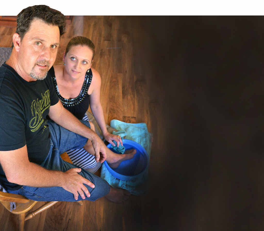 Jason Austin of The Palms being attended by his wife Anne after being speared in the inside of his left foot by a stingray whilst fishing at Tinnanbar, Great Sandy Strait over the Easter holiday. PHOTO: GREG MILLER