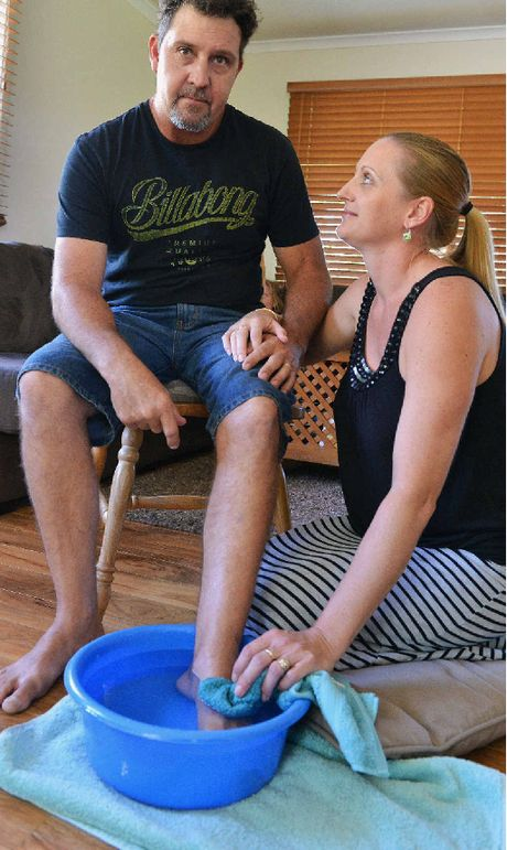 Jason Austin of The Palms being attended by his wife Anne after being speared in the inside of his left foot by a stingray whilst fishing at Tinnanbar, Great Sandy Straight over the easter holiday. Photo Greg Miller / Gympie Times