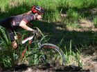 Eva Plessing, a three-time world title winner in tae kwon do has turned her hand to mountain biking in Mackay.