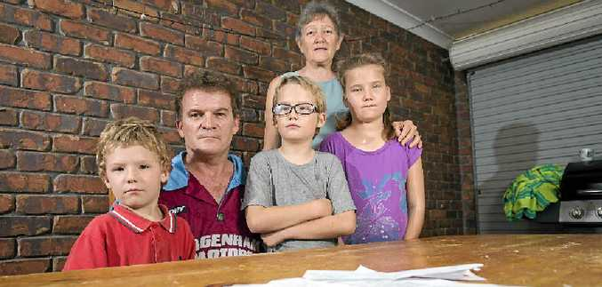 IN DISTRESS: Noah, 5, Liam, 8, Olivia, 10, and former husband Wayne are gravely concerned for the welfare of their loved one due to what they say is a lack of support for mental health patients in Gladstone.