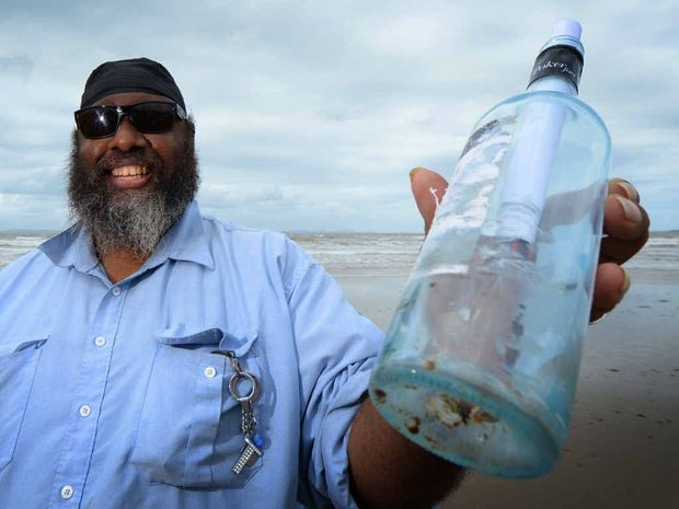 INTRIGUING FIND: Jason Ivey holds the message in a bottle he and his niece Tiah Crowther discovered on Farnborough Beach.