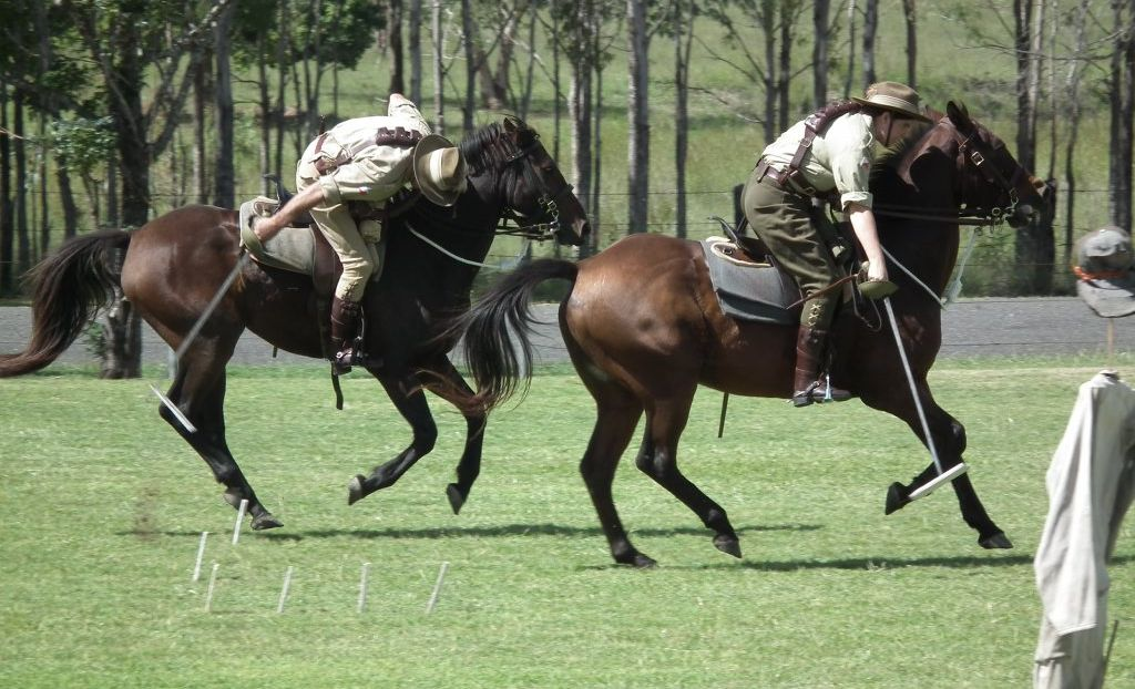 LIGHTHORSE IN ACTION: Members of the Gympie Light Horse troop show their skills to the Biggenden State School students at their Anzac Day service on Thursday.