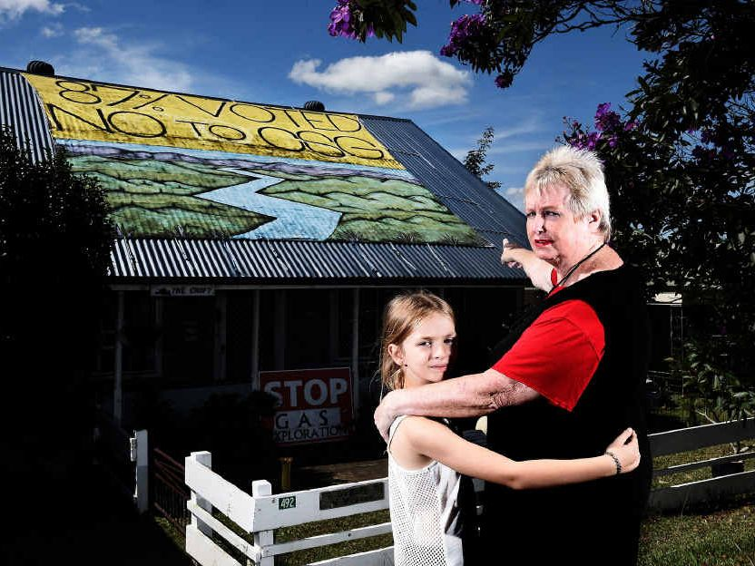 COUNCIL ACTION: Jenny Leunig with her granddaughter Kiah McCarthy, 8, in front of her artwork which she is hoping to keep attached to the roof of her house on the Bruxner Hwy in Goonellabah.