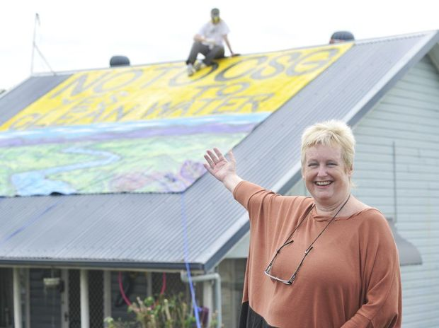 Jenny Leunig, of Lismore, shows off her giant protest sign against CSG painted by Julla Livingston.