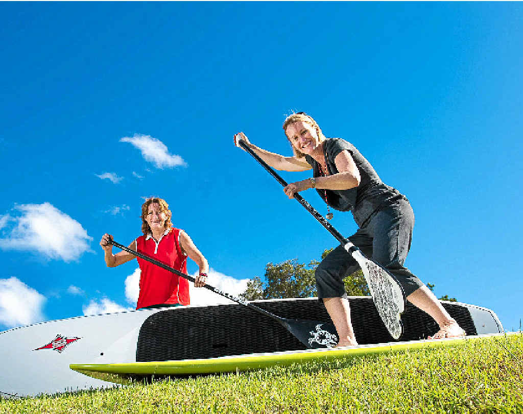 STAND UP: Debbie Gentle and Janet Mayes get ready to paddle for charity.