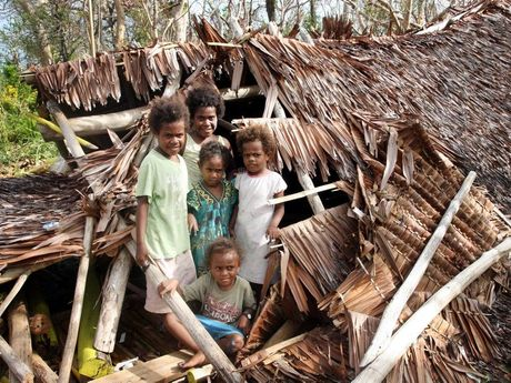 Children play in the collasped roof of their preschool at Karngo. Vanuatu aftermath from Cyclone Pam. Photo Vicki Wood / Caboolture News