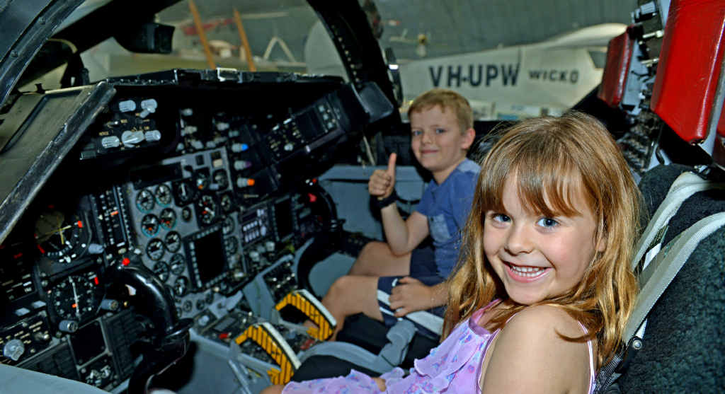 WOW FACTOR: Thomas and Emily McKenzie in an F-111 cockpit at Caloundra Airport during the Queensland Air Museum Aero Engine Run Day. More photos on Page 42.