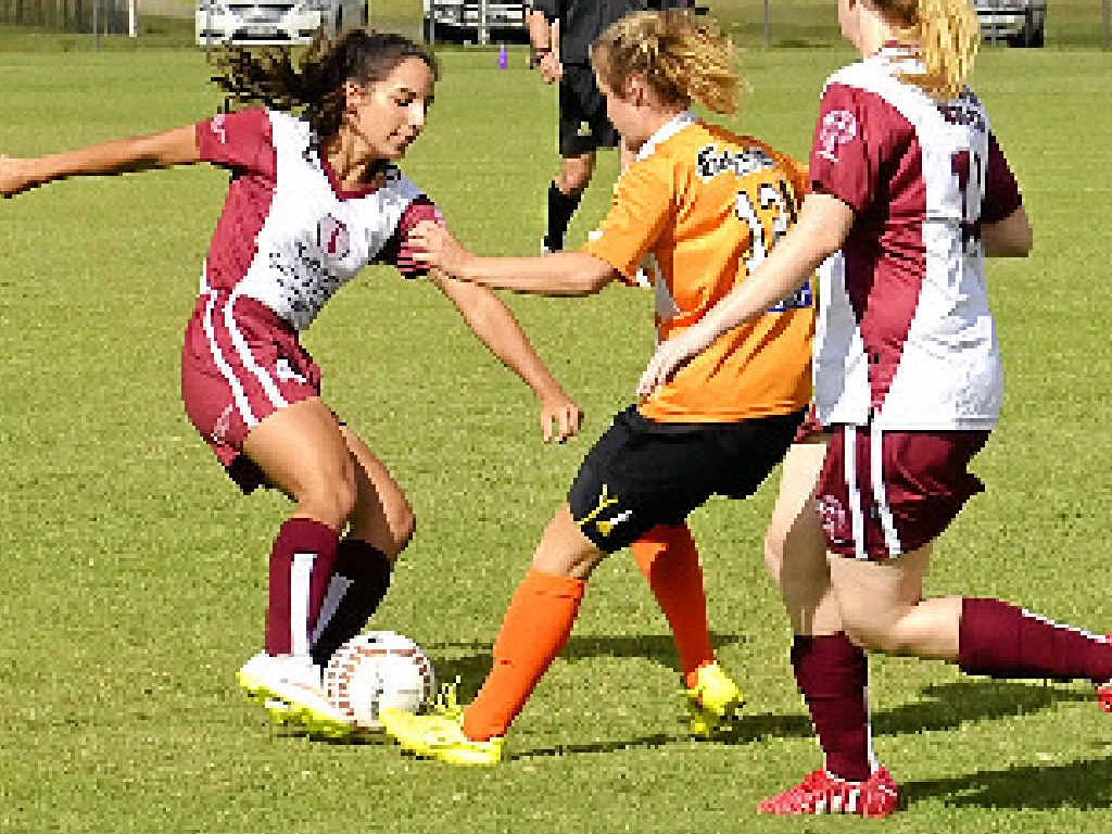 STAR PLAYER: Maddy Ross (left), pictured in round 1 earlier this season, scored one of the two Warwick goals yesterday.