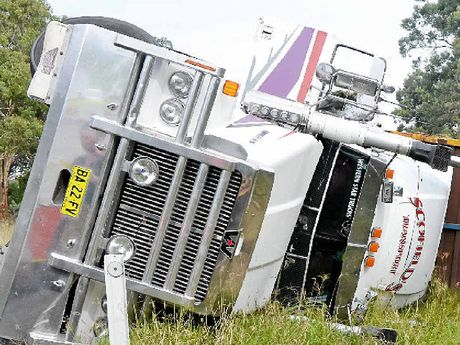 A double-decker Scofield's livestock truck travelling north from Stanthorpe rolled on the New England Hwy just before the turn-off to Turner's Creek Rd at Dalveen.