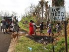 People line up to get water from Expats. Vanuatu aftermath from Cyclone Pam. Photo Vicki Wood / Caboolture News
