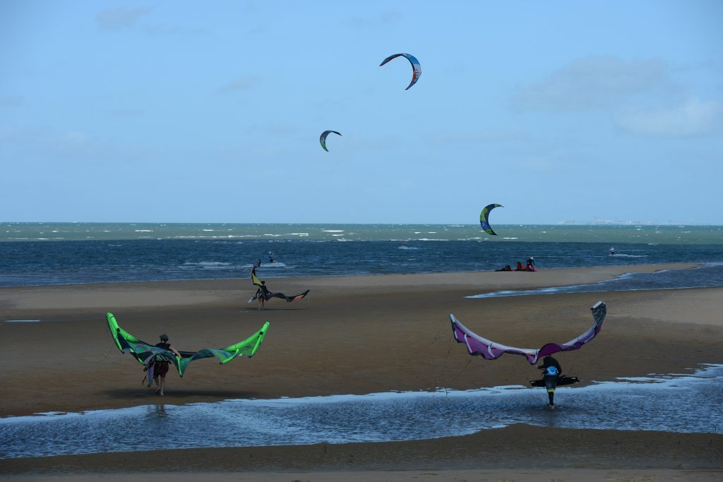 Louw Olivier, Stacey Cornick and Jason Lamb take advantage of the wind and sun and join kitesurfers at Town Beach on Saturday. Photo Lee Constable / Daily Mercury