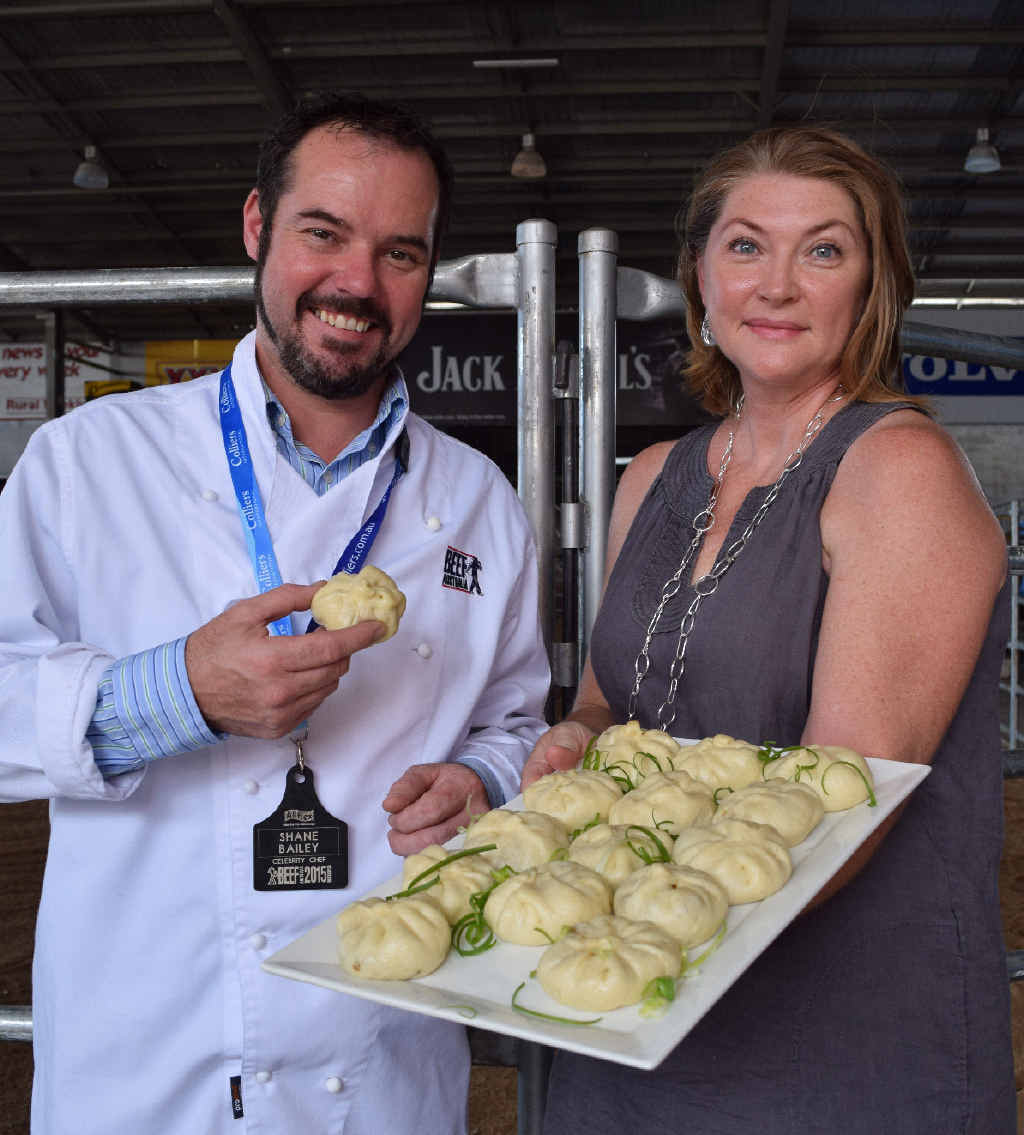 DELICIOUS DISH: Chef Shane Bailey with Rockhampton's Amanda Lawrence and her Sichuan Steamed Buns, which will be served at Beef Australia .