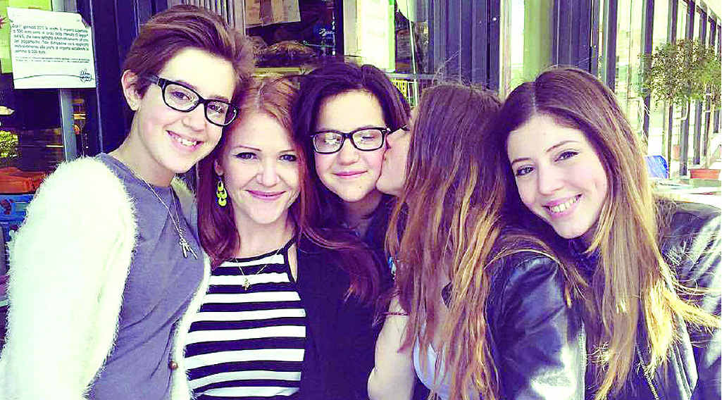 REUNION: The four sisters, Lily, Christine, Emily and Claire with their mother in Italy.