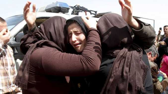 Members of the minority Yazidi sect who were newly released hug each other on the outskirts of Kirkuk April 8, 2015
