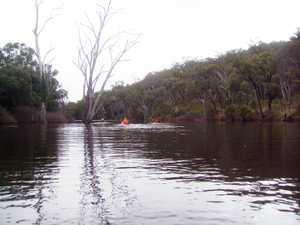 Kayaks on Eungella Dam after an overnight camp