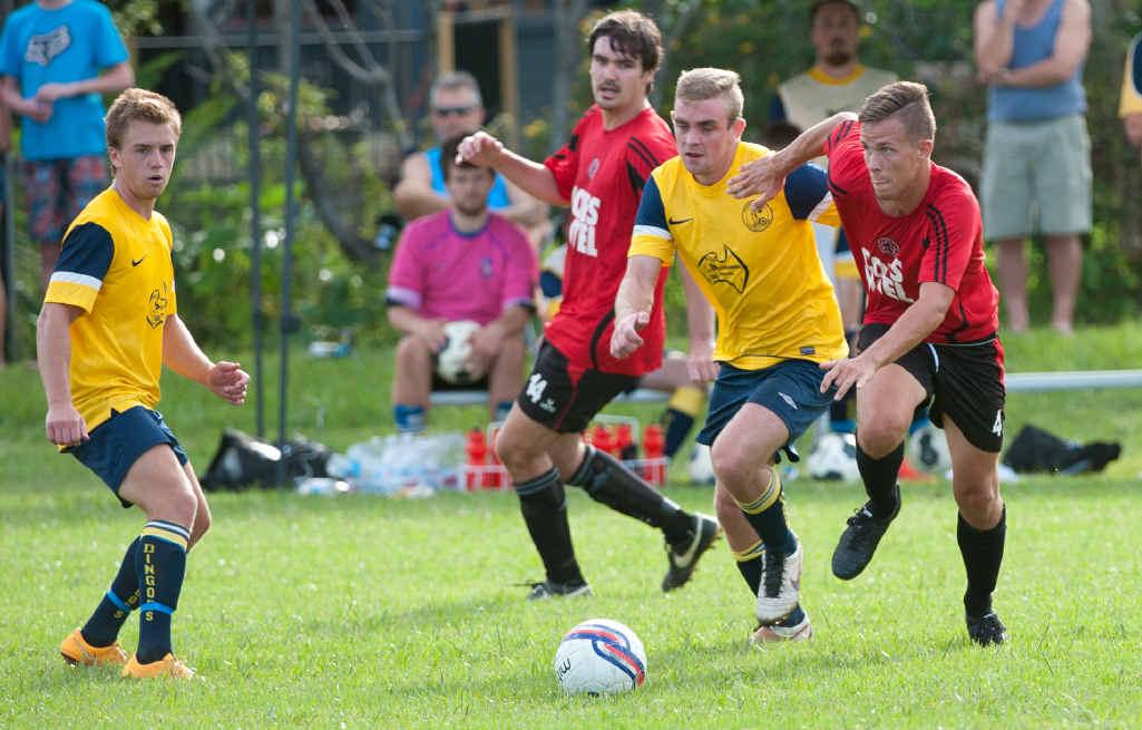 IN STEP: Coffs United's Aaren Alsop keeps the ball close as Orara's Josh Chapman closes in.Gemima Harvey