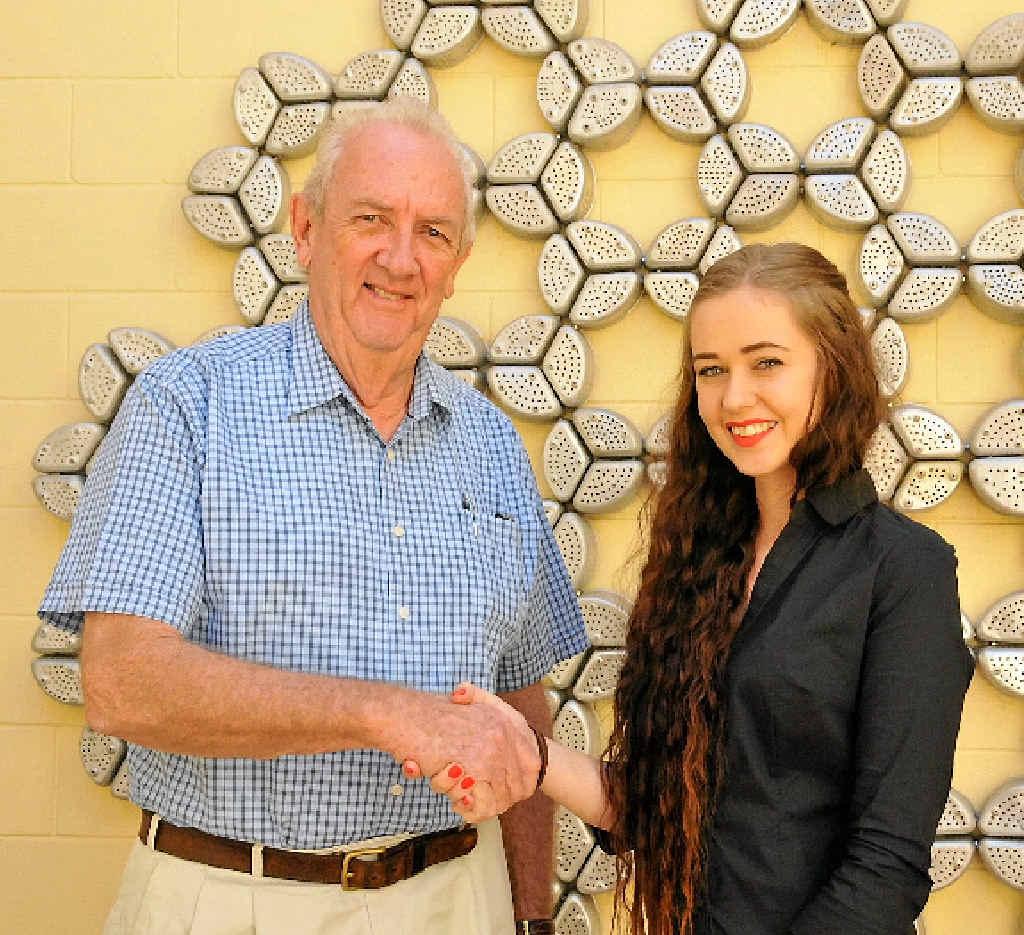 FINE WORK: Gladstone Regional Art Gallery and Museum Society president Bruce Hunt congratulates Cassandra Paddick on her award win.