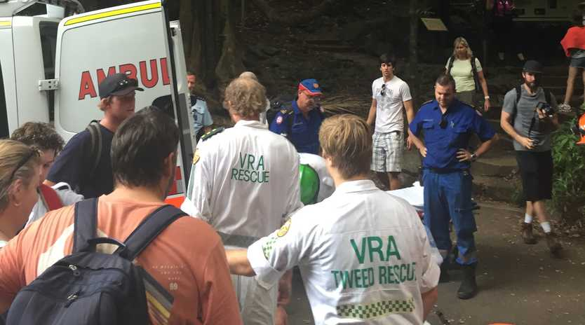 Two people were rescued from Mount Warning on Sunday after suffering ankle injuries.