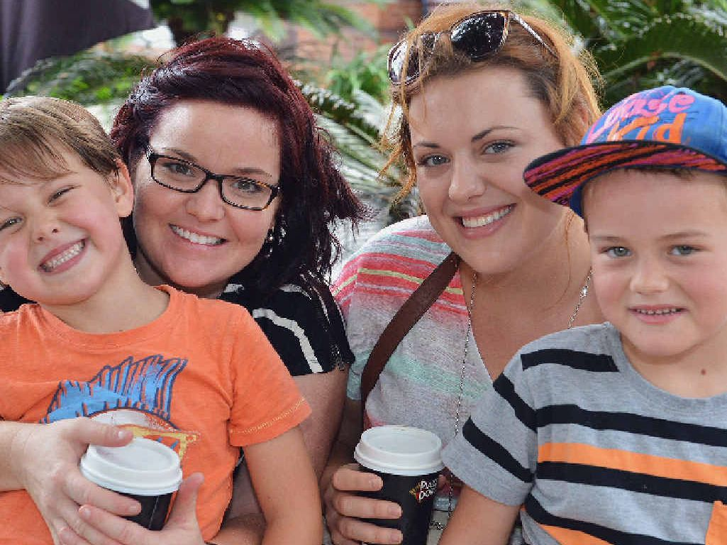 CELEBRATING YOUTH: Ari Ogden, 4, with Amy Cornelius, Sarah Duffy and Isaac Ogden, 6, in Mary St yesterday.