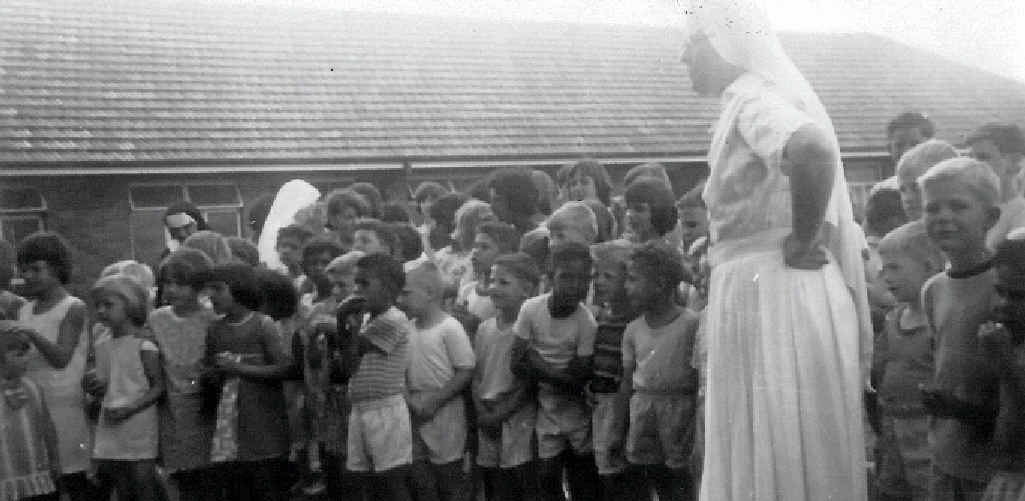 TOUGH TIMES: A nun at Neerkol Orphanage with children in the care of the Sisters of Mercy.