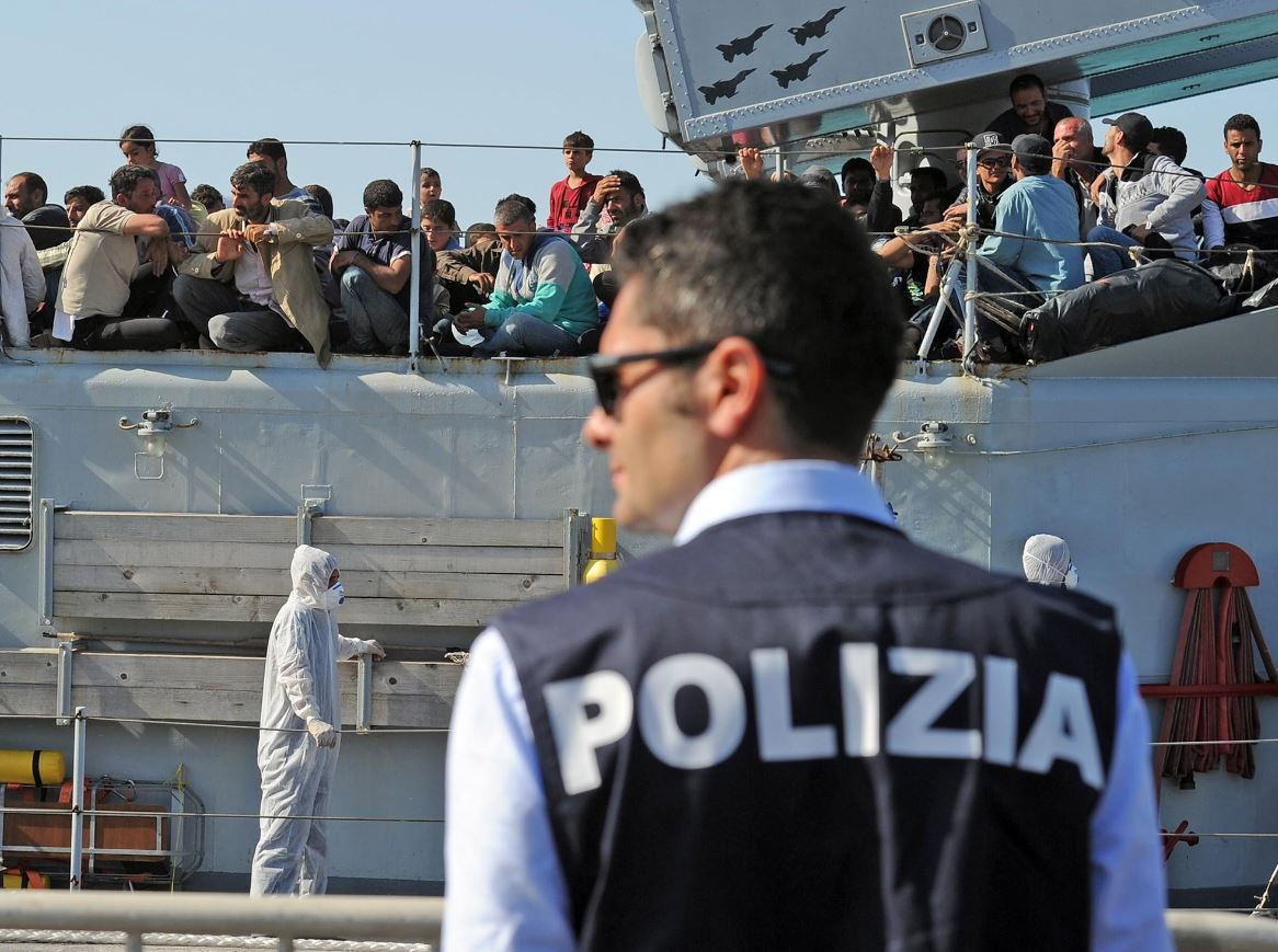 An Italian military ship with would be immigrants onboard in the port of Pozzallo, Sicily, last year